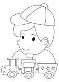 Página dibujada mano del colorante de un muchacho y de sus trenes del juguete Imagen de archivo libre de regalías