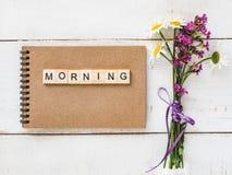 Página en blanco de un cuaderno con las letras y la palabra MAÑANA imágenes de archivo libres de regalías