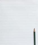 Página en blanco del cuaderno con el lápiz Foto de archivo