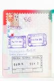 Página suiza del pasaporte con los sellos de visa Imagen de archivo