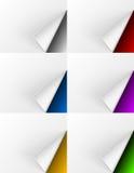 Páginas dadas vuelta blanco en diversos fondos de los colores Foto de archivo