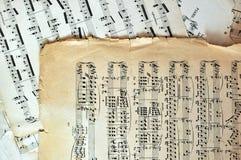 Páginas velhas da folha de música - fundo da arte fotografia de stock