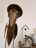 Pájaro del metal en el fondo blanco Fotografía de archivo