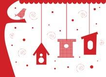 Pájaro en árbol con las casas del pájaro Fotografía de archivo libre de regalías
