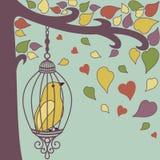 Pájaro-en-jaula-y-otoño-deja Fotografía de archivo