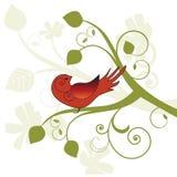Pájaro estilizado en un árbol Imagen de archivo libre de regalías