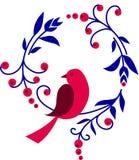 Pájaro rojo que se sienta en una ramificación con las flores Imagenes de archivo