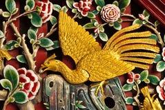 Pájaro tallado en la madera Fotografía de archivo