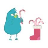 Pájaro y caramelo azules de la Navidad en el calcetín stock de ilustración