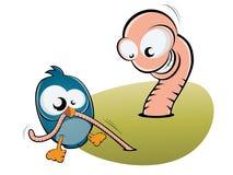 Pájaro y gusano Imagen de archivo