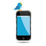 Pájaro y teléfono celular Imagenes de archivo