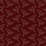 Pájaros de papel de la papiroflexia en fondo rojo Imagen de archivo libre de regalías
