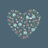Pájaros del amor en un corazón floral Fotos de archivo libres de regalías