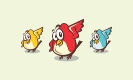 Pájaros divertidos coloridos de la historieta con la cara linda Foto de archivo