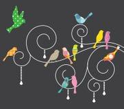 Pájaros en remolinos decorativos. Imagen de archivo libre de regalías