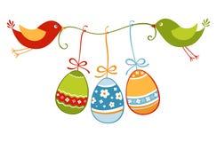Pájaros y huevos de Pascua Imagen de archivo