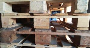 Páletes de madeira no armazém Imagem de Stock Royalty Free