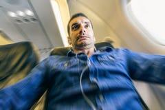 Pánico del pasajero del aeroplano imágenes de archivo libres de regalías
