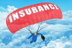 Pára-quedas do seguro fotografia de stock