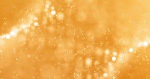 Párticulas de polvo del brillo de la chispa de la pendiente del oro de la Navidad del top en fondo negro con el movimiento el flu metrajes