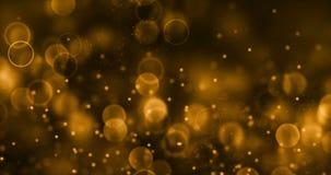 Párticulas de polvo del brillo de la chispa de la pendiente del oro de la Navidad del top en fondo negro con el movimiento el flu almacen de video