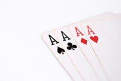 Pás reais do flash do casino dos cartões de jogo Quatro áss em um fundo branco copyspace, sumário da sorte Fotografia de Stock Royalty Free