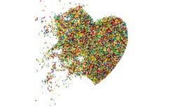 A Páscoa polvilha, confeitos no coração do formulário, isolado no fundo branco Foto de Stock Royalty Free