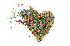 A Páscoa polvilha, confeitos no coração do formulário, isolado no fundo branco Fotos de Stock Royalty Free