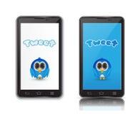 Pássaro azul no telefone do ndroid Imagens de Stock