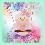 Pássaro cor-de-rosa da Páscoa no fundo da flor da mola Imagem de Stock