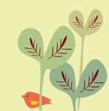 Pássaro e folhas grandes Imagem de Stock