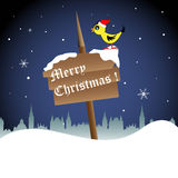 Pássaro em uma placa de madeira do Natal Imagem de Stock Royalty Free