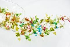 Pássaros de papel no frasco de vidro Imagem de Stock