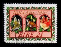 Pássaros; música da ilustração os doze dias do Natal, serie 1987 do Natal, cerca de 1987 imagem de stock