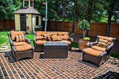 Pátio e mobília do tijolo Imagens de Stock Royalty Free