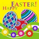 Pâques a coloré la carte de voeux - oeufs avec des fleurs Photographie stock libre de droits