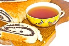Pâtés et cuvette frais de thé Photographie stock