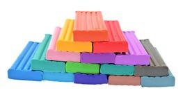 Pâte à modeler colorée d'isolement sur le fond blanc Photos stock