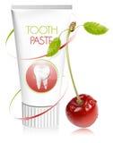 Pâte dentifrice avec la cerise. Image stock