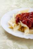 Pâtes avec le sause de tomate Photographie stock libre de droits
