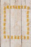 Pâtes de Farfalle formant le cadre Image libre de droits