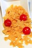 Pâtes et tomate de pachino images libres de droits