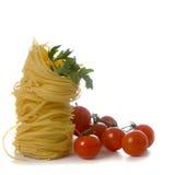 Pâtes et tomates fraîches Images stock