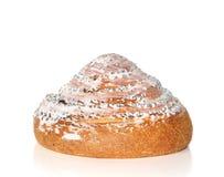 Pâtisserie avec la glaçure blanche et le pavot bleu image stock
