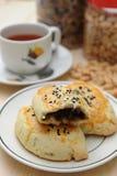Pâtisserie et thé image stock