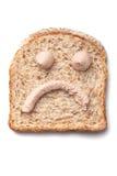 Pâté spridningsmiley på skiva av bröd Royaltyfri Fotografi
