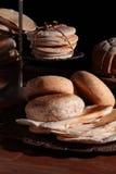 Pães em uma tabela Fotos de Stock Royalty Free