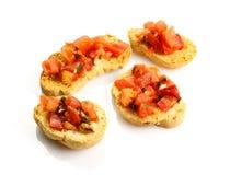 Pão brindado com tomate Imagens de Stock Royalty Free