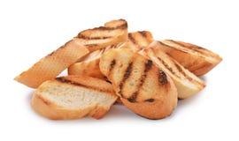 Pão brindado queimado no fundo branco fotos de stock royalty free