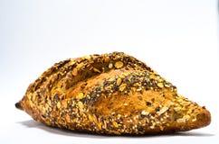 Pão com as sementes no fundo branco imagens de stock